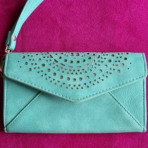 Turquoise wallet w/ cutout details.RFID protection